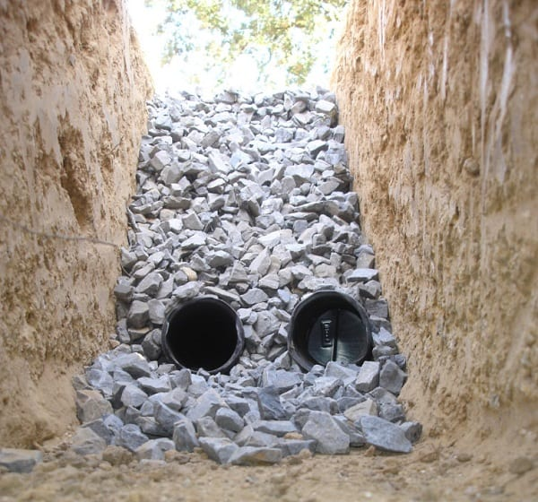Two-pipe French drain without geotextile fabric